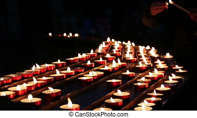 Burning candles in the church.