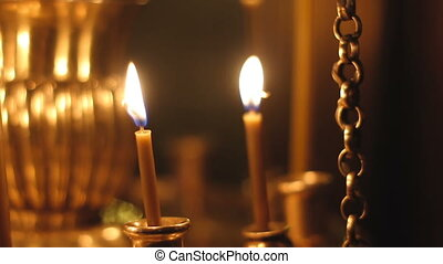 burning candles in the Church