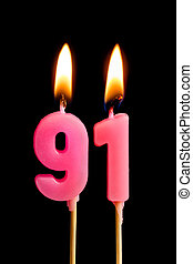 Burning candles in the form of 91 ninety one (numbers,...