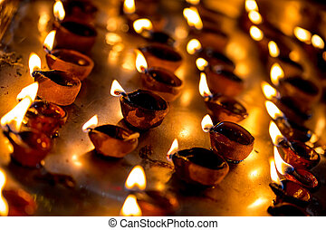 Burning candles in the Indian temple. Diwali the festival of...