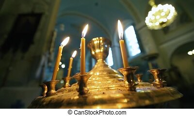 Burning Candles Inside a Church