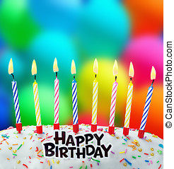 burning candles on a birthday cake - burning candles on a...