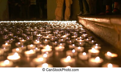 Burning Candles on the Churches Ground