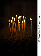 Burning candles over black background