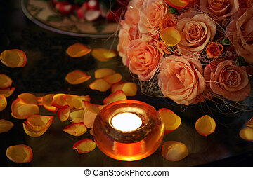 Burning candles roses and petals