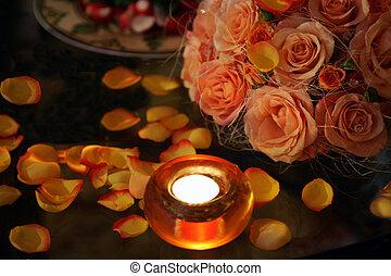Burning candles roses and petals