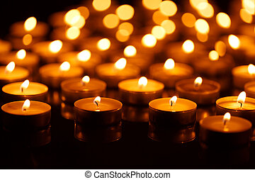 Burning candles with shallow depth of field - Many burning ...