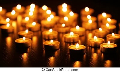 Burning candles with shallow depth of field - Many burning...
