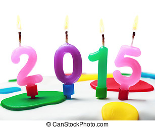 burning candles with the symbol of the new year 2015