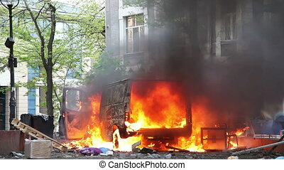 Burning car in the center of city