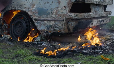 Burning car tires, the car burns a wheel, a completely burnt...