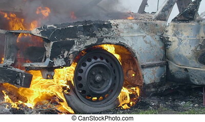 Burning car tires, the car burns a wheel, a completely burnt...