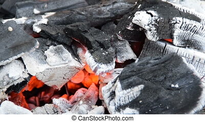 burning charcoal on the grill
