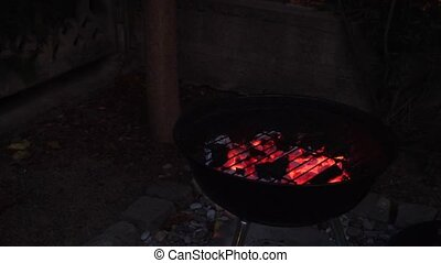 Burning coal in bbq grill - Hot coal burning under grating...