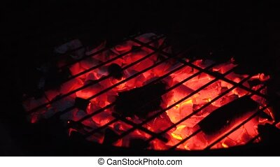 Burning coal in grill - Hot coal burning under grating in...
