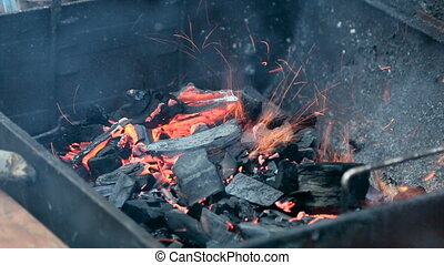 burning coals in the brazier