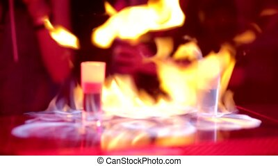 Burning cocktail in night club