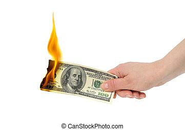 burning dollar - burning dollar in hand isolated on a white...