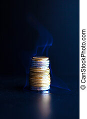 burning dollars and euros in coins. a burning financial pyramid of money capitalization