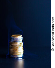 burning dollars and euros in coins. a burning financial ...