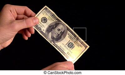 Burning dollars in the hands of men