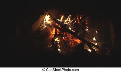 burning down campfire - topview of blazing and only slightly...