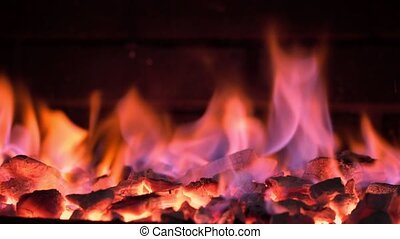 Burning embers of a fire in a brazier for cooking food on ...