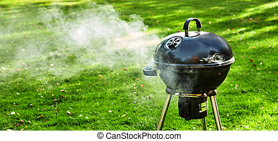 Burning fire in a portable BBQ venting smoke