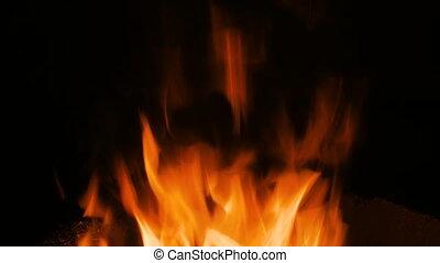 Burning fire in furnace at forge, workshop. Blacksmith...