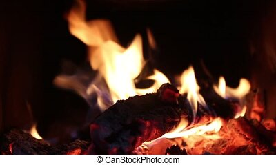 Burning fire inside of oven with dark background - Fireplace...