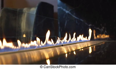 Burning fireplace of a luxury hotel
