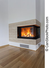 Burning fireplace - Vertical view of fireplace with burning...
