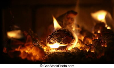 Burning firewood. - Close-up of burning firewood in the...