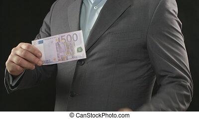 """Burning five hundred euro bill, money wasting, spending, loser"""