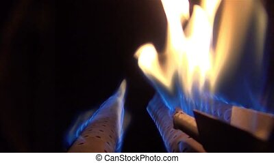 burning flame in the gas burner of the boiler