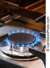 Burning gas stove with blue flames