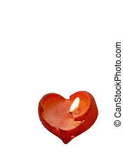 Burning heart shaped candle