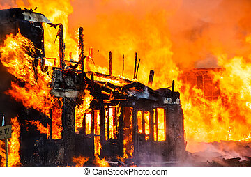 Burning old wooden house