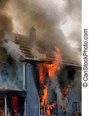 Burning House - Flames and fire engulf a burning house
