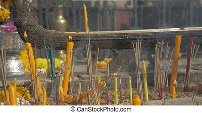 Burning incense and candles in Bangkok, Thailand - Many...