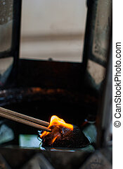 Burning incense from the oil lamps
