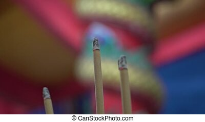 Burning incense sticks in Chinese temple - Closeup of...