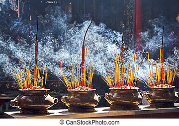 Burning incenses - Incense burning in a Buddhist temple