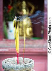 Burning joss sticks in pagoda, Saigon, Vietnam