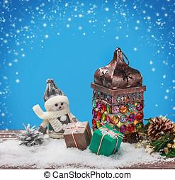 Burning lantern and Christmas decorations