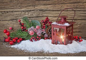 Burning lantern in the snow