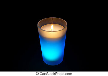 burning light blue candle isolated