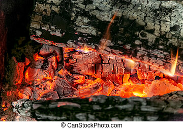 Burning log of wood close-up as abstract background.