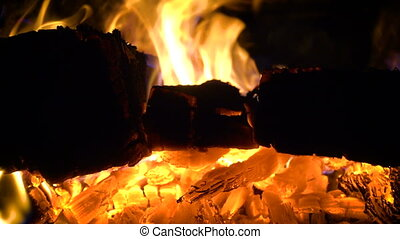 burning logs at the stove close up video