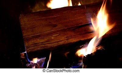 Burning logs - Flames and logs burning in fireplace.